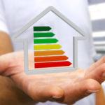 businessman-holding-3d-eco-house-energy-efficiency_117023-327